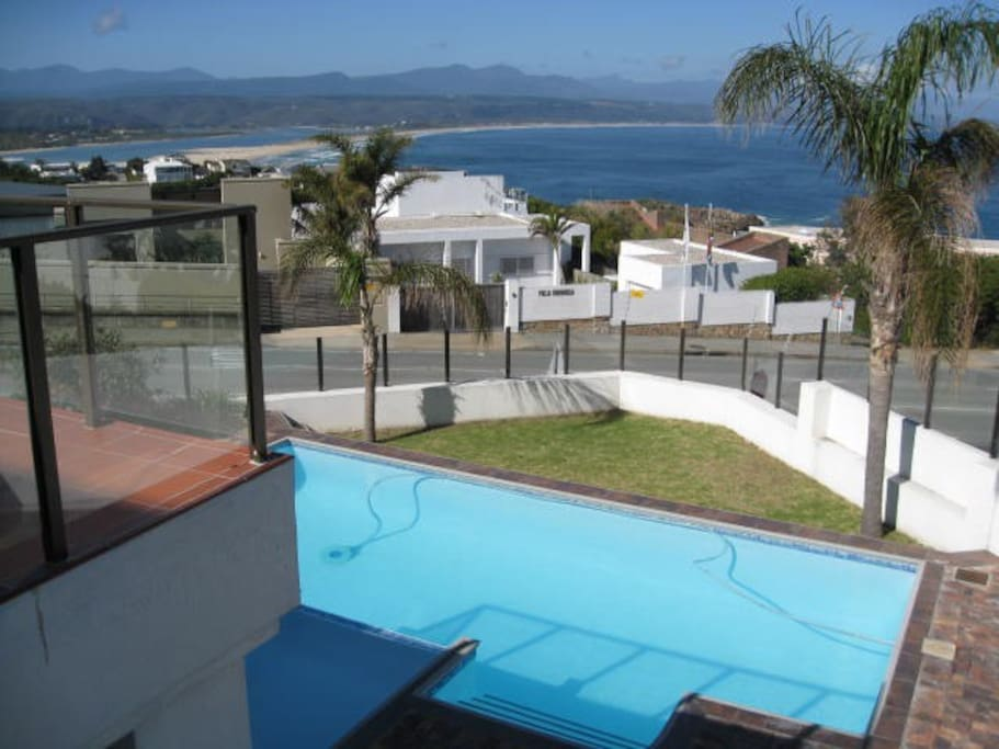 Take a refreshing dip in the pool while enjoying the seaviews