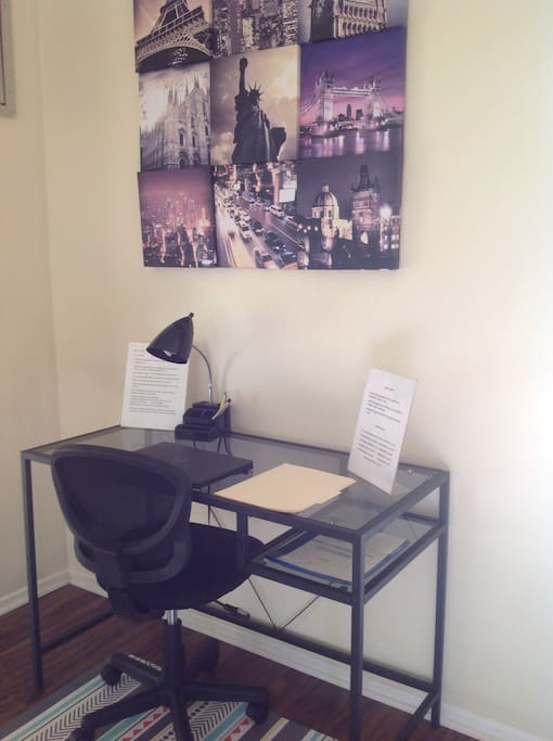 Work station with desk lamp USB charging station office accessories/brochure of attractions in the area. House Rules.