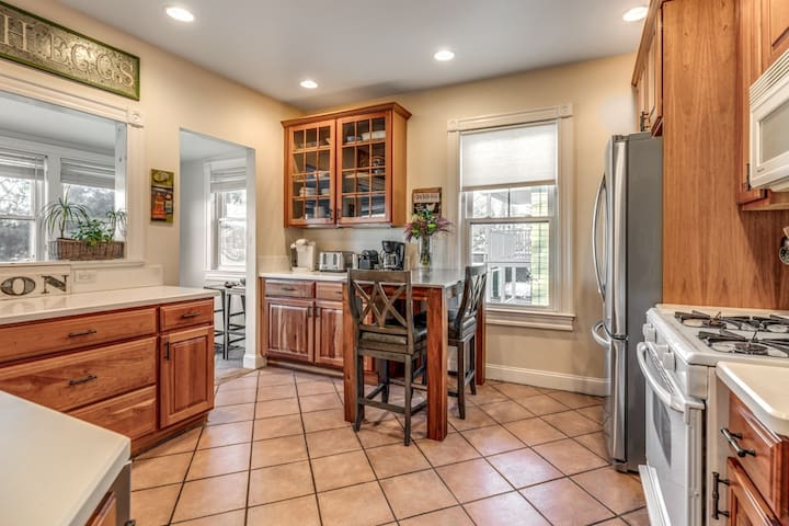 Generously sized kitchen with stainless appliances and ample seating in two areas