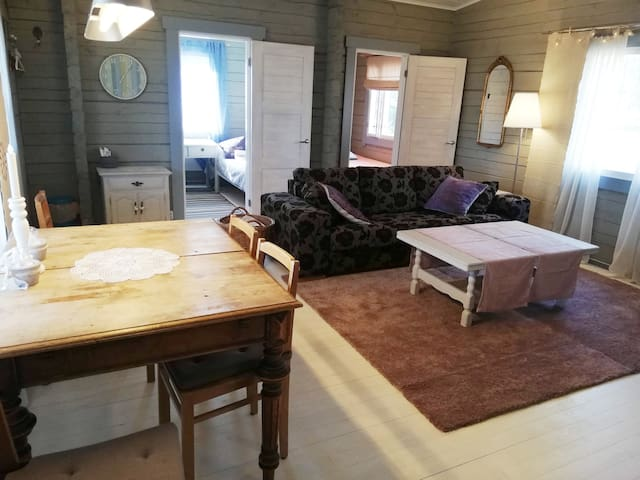 Cottage's living room, all beds are in their own separate rooms.