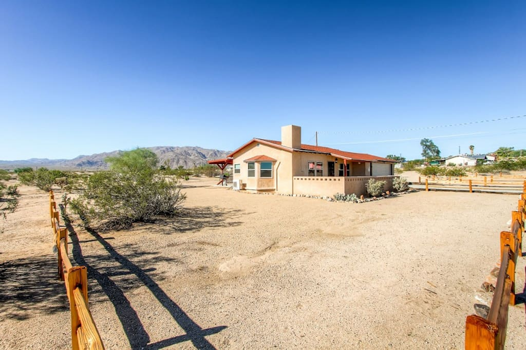 The house is surrounded by beautiful mountain and desert views.