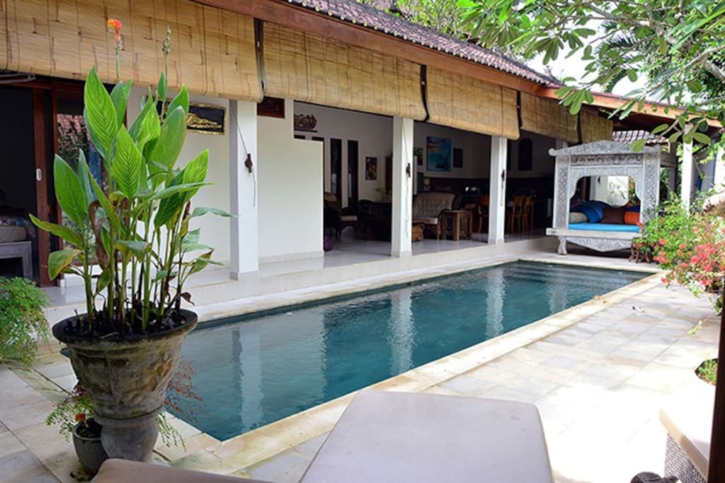 The pool invites you to swim from every part of this villa.