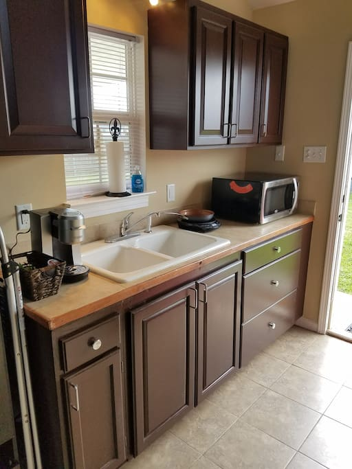 kitchen with coffee maker, Nuwave hot plate and microwave