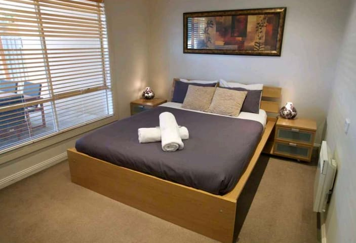 Main bedroom with Queen size bed , built in wardrobe and wall-mounted panel heater to keep you warm