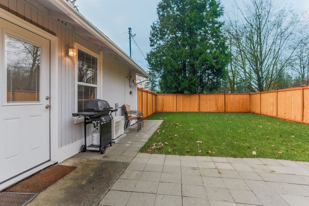 Fenced, stone patio and grill