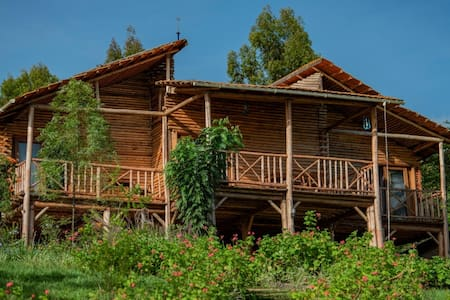 Cottages built in traditional way at Lake Muhazi.