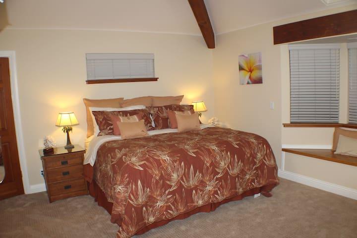 Tropical ocean themed, spacious, luxurious room.