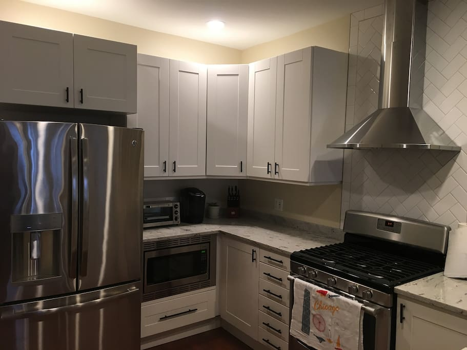 Fully functional kitchen with 5 burner stove/oven, microwave, Keurig, toaster oven and refrigerator.