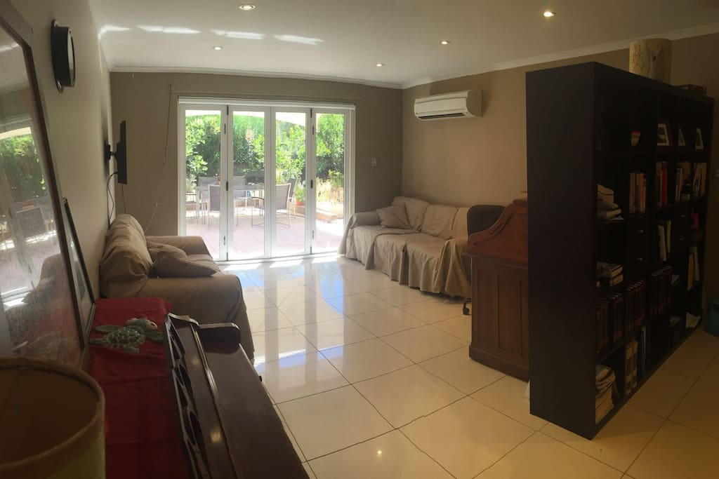 Bi-fold doors from living area to paved private court yard.