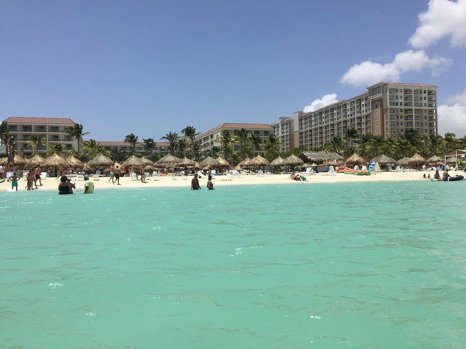 Clean, expansive beach with turquoise waters