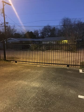 Completely enclosed, secured parking with remote controlled gate.