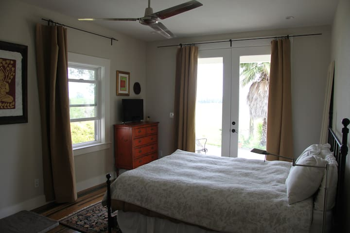 Master Bedroom... from bed you have a massive view, through french doors, over the country side and town