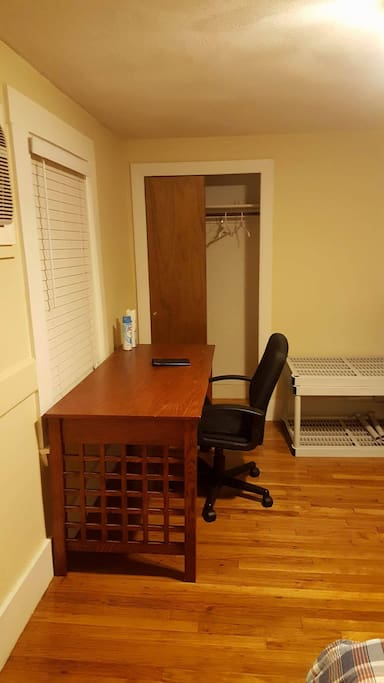 Large desk with comfortable desk chair. Closet for hanging belongings.
