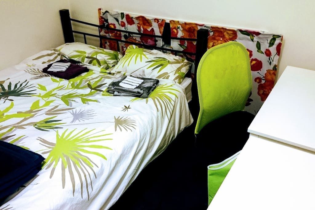 Queen size bed in the guest room