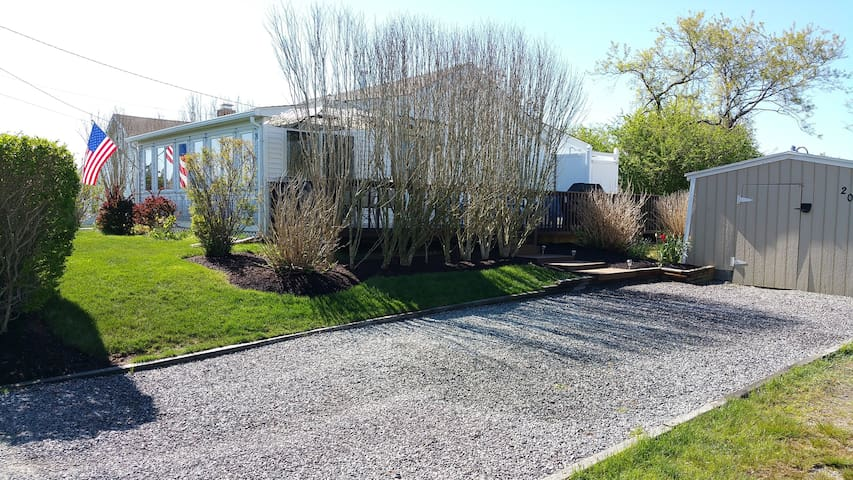 Side view of home with ample off street parking