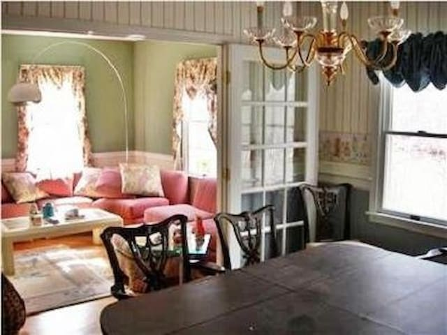 Gracious living room with french doors to dining room