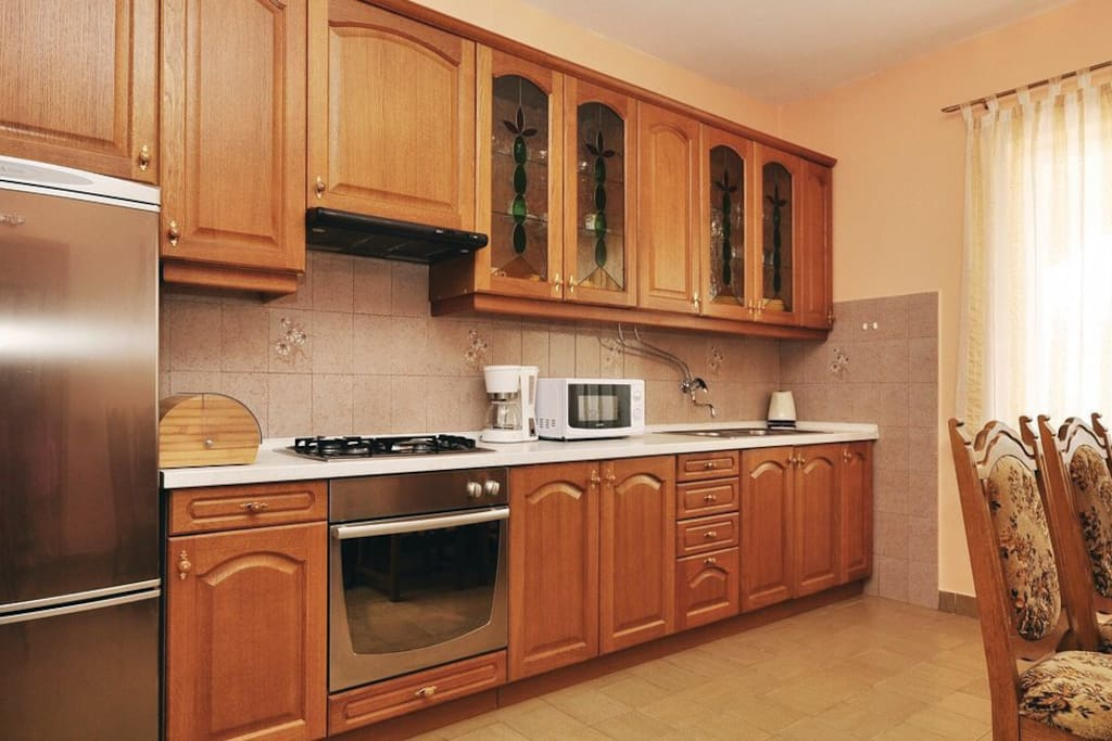A spacious kitchen with microwave, coffee maker, electric kettle.