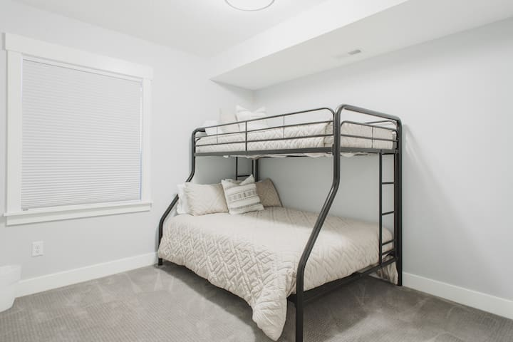 Bunk room with twin bed on top and double on bottom.