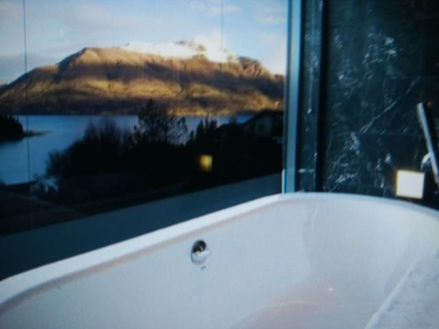 Bathtub with transparent windows