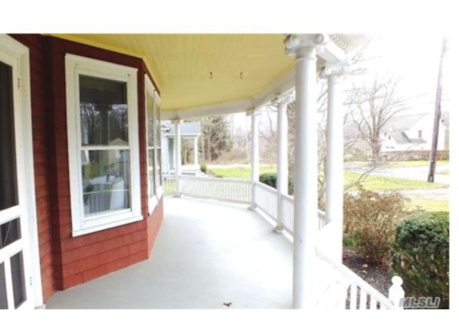 Wrap around porch. Not shown are rocking chairs, awning and tables (it was winter)
