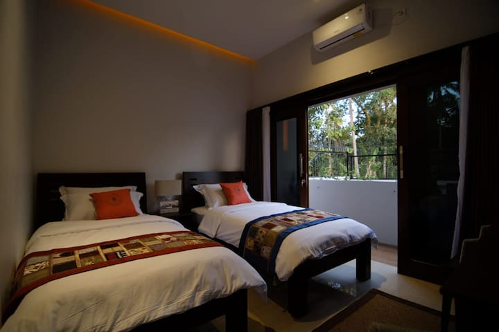 Twin Bed Room - Second Floor, with En-suite bathroom, hot water, air conditioner & TV