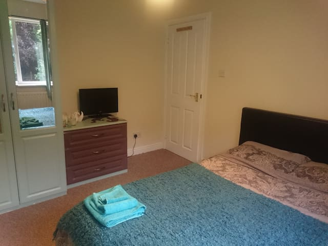 Double bed in a warm and friendly home