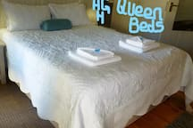 A clean Queen size bed for two.