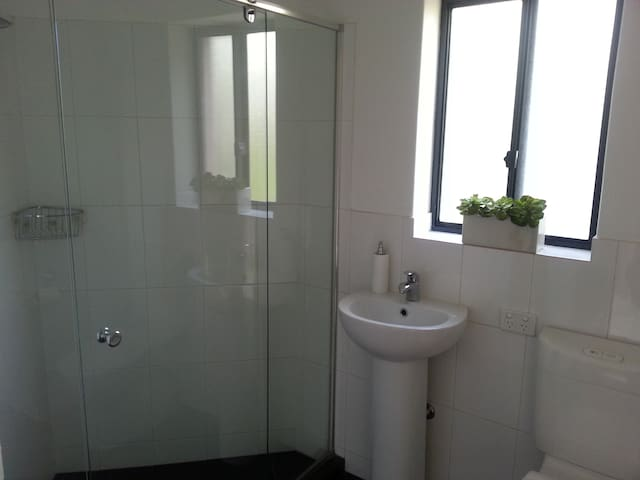 Private sparkling bathroom as part of the students retreat