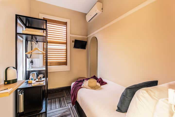 Compact Single Room, Allocated Bathroom