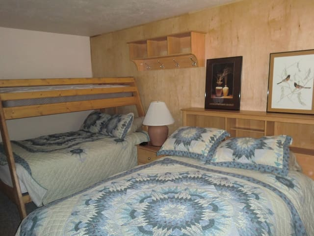 Second bedroom:  one queen, one double in bottom with twin on top bunk, private bathroom.  Exterior door access on west side for ski locker and ski slopes.