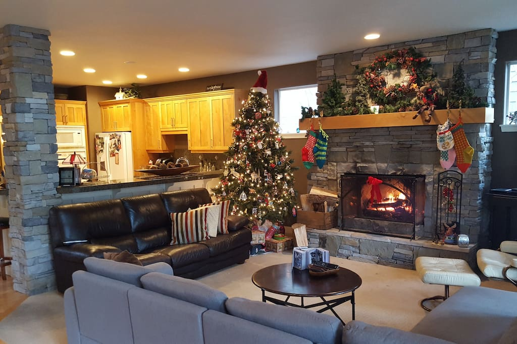great room with real wood burning sone fireplace, adjoining huge kitchen with granite countertops.