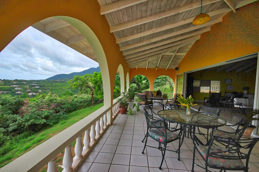 Dining and lounging under covered patio, to mountain views and ocean views.