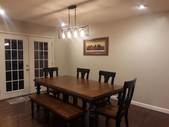 Dining room with door leading to back deck.