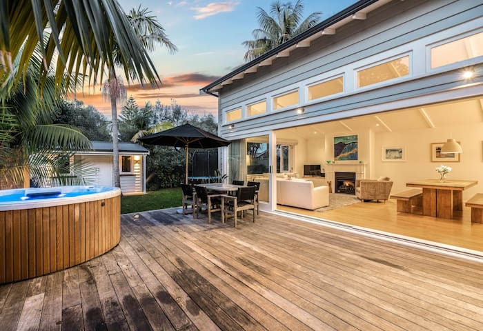Main deck with outdoor table, BBQ and spa pool