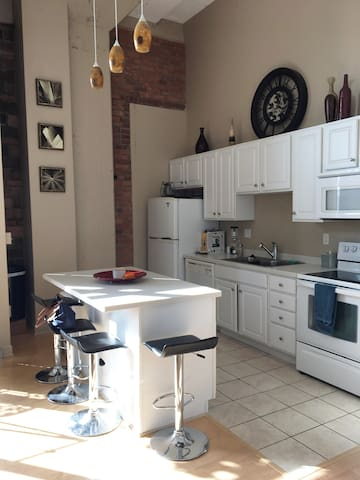 Full kitchen including refrigerator, stove and dishwasher. All the essentials to prepare your own meals.