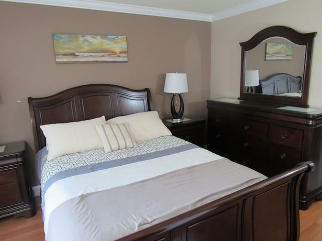 Master bedroom with dresser drawer.