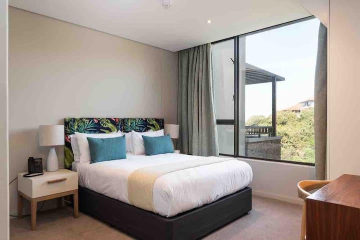 Main bedroom with sea views, TV and en-suite bathroom