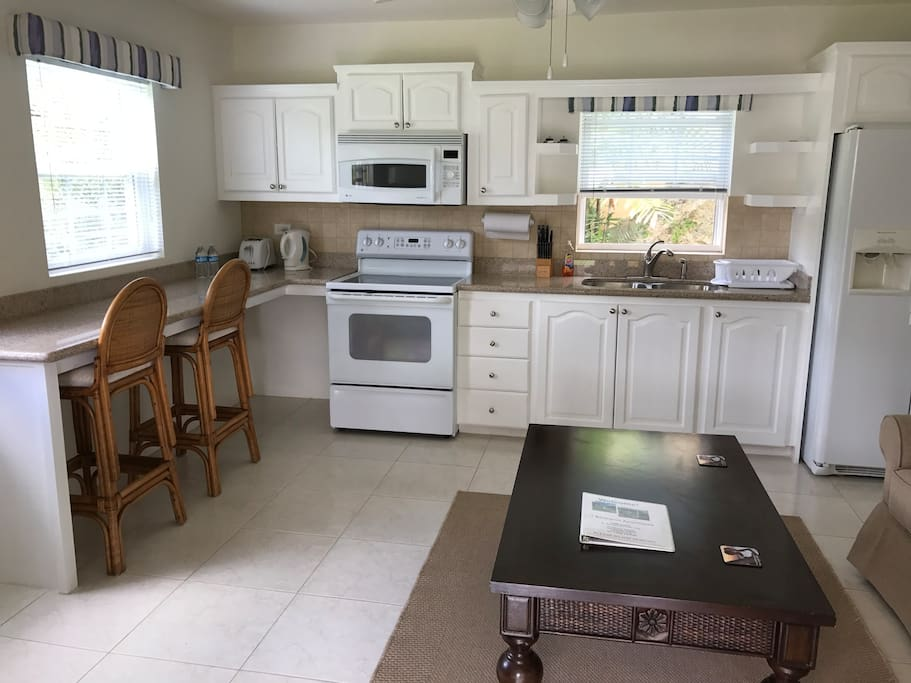 Features full kitchen with full sized fridge, stove and microwave
