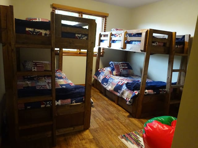 Bunk room with 4 twin size beds.