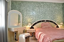 Big room: 180cm bed, dresser, 2 set of side drawers, big closet, TV, Cable, Air conditioned
