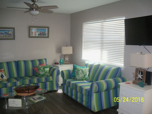 Living room area with Wall mounted television, private WIFI