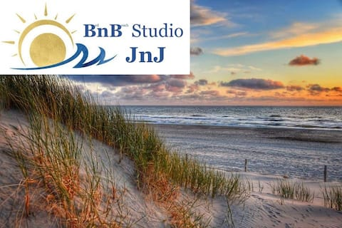Studio JnJ, right at the beach entrance the signal post