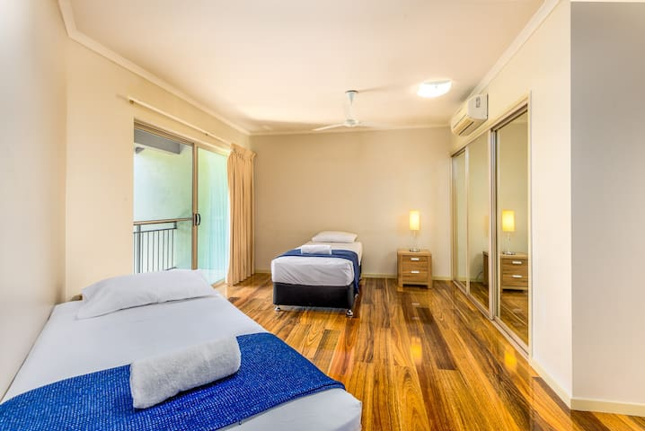 In the third bedroom there are two single beds ideal for those travelling with the kids. The bedroom has air-conditioning and a private balcony overlooking the pool.