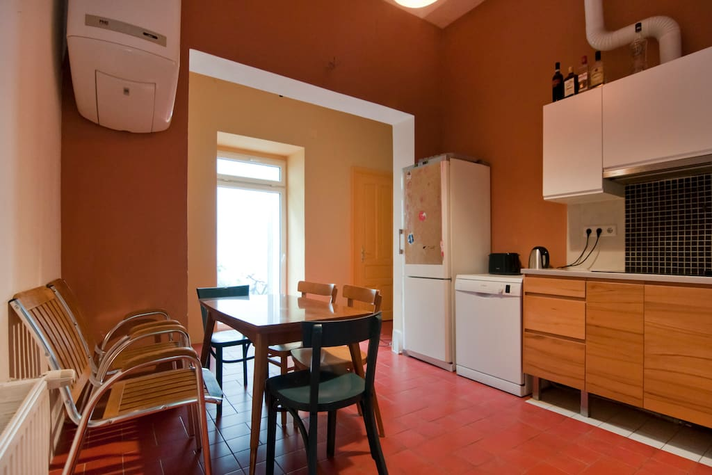 The kitchen with refridgerator, dishwasher, electric stove, kettle, toaster, and much more