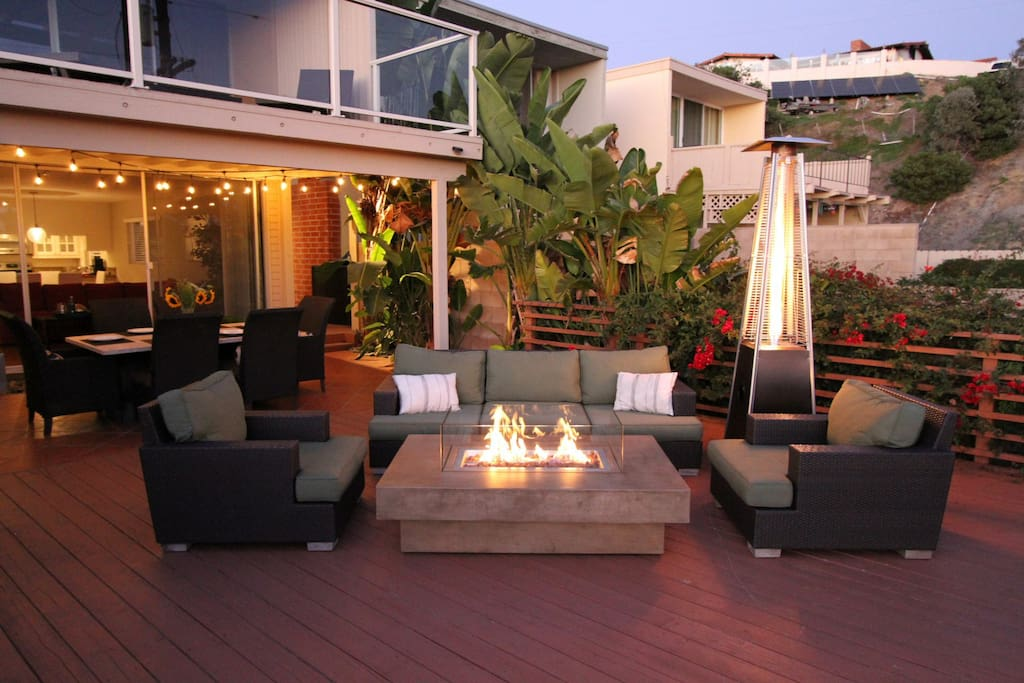 Relax with family and friends by the fire table on our expansive back deck