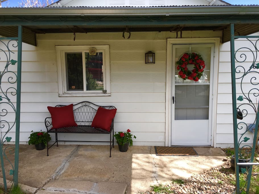 Front porch with bench.