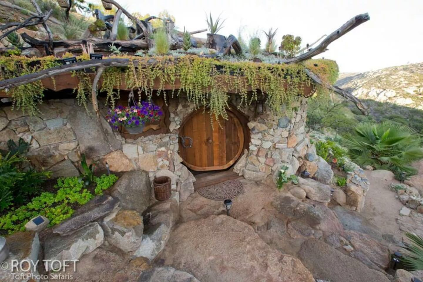 "The hobbit house, built partially underground, complete with a temperature insulating ""living roof""."
