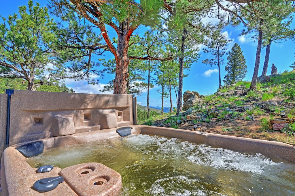 The home is situated on 3 acres and borders Roosevelt National Forest.