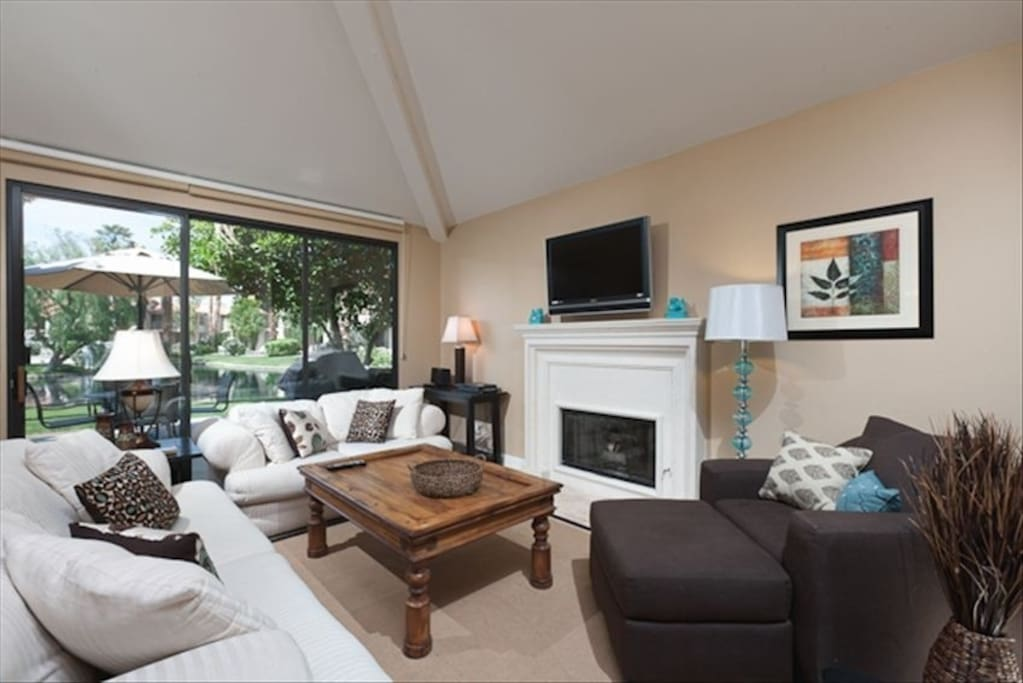 An open and spacious living area offers plenty of seating and a flat-screen TV.