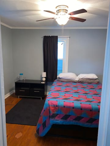 Bedroom with queen bed, dresser, luggage rack, closet (3 baby gates, pack and play, vacuum, and extra sheets in closet), TV (antenna access with local channels and Netflix)